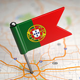 Portugal Small Flag on a Map Background.