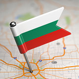 Bulgaria Small Flag on a Map Background.