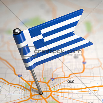 Greece Small Flag on a Map Background.