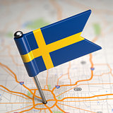 Sweden Small Flag on a Map Background.