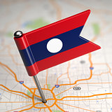Laos Small Flag on a Map Background.