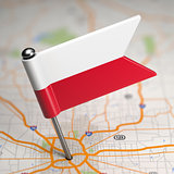 Poland Small Flag on a Map Background.
