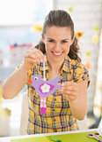 Happy young woman showing easter decoration