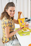 Happy young woman making easter basket