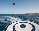 Parasailing from the back of speedboat