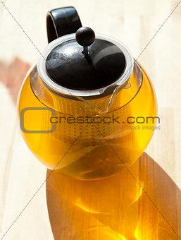 green tee in glass teapot