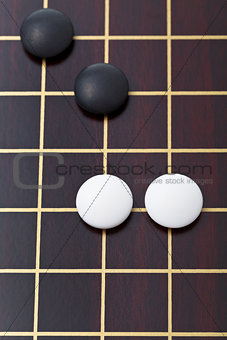 top view of few stones during go game playing