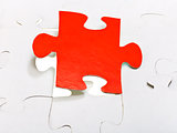 red piece attached in assembled puzzles