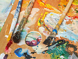 paint brushes on wood artistic pallette