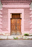 Door in a pink wall