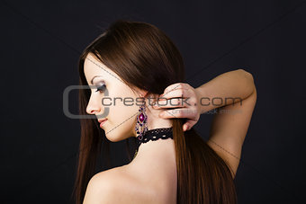 Beautiful young girl in profile with long straight hair