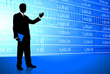 Businessman on Stock Market Background