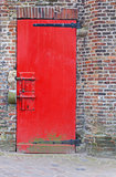 Heavy red wooden door with security bolts