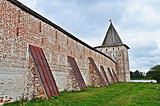 Wall with buttresses and tower of ancient monastery