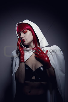 Sensual fetish woman wearing white hooded jacket
