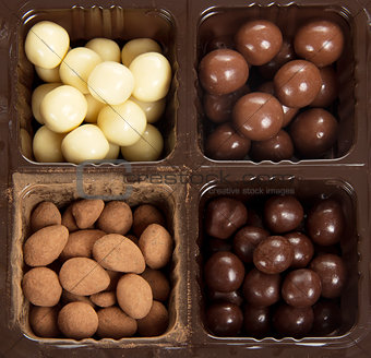 Box with different round candies