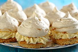 Meringue cakes with cream.
