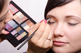 Makeup artist colors upper eyelids model