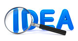 Idea - Blue 3D Word Through a Magnifying Glass.