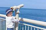 boy using seaside binoculars