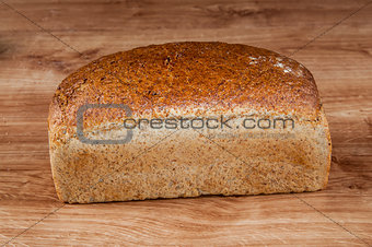 fresh bread on the brown wooden table