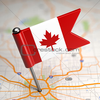 Canada Small Flag on a Map Background.