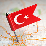 Turkey Small Flag on a Map Background.