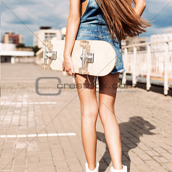 beautiful lady with long silky hair in denim short overalls