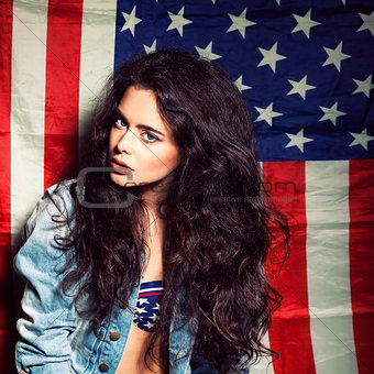 beautiful sexy long haired girl against american flag