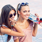 two beautiful young girls in sunglasses