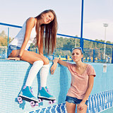 two beautiful young girls in an empty pool