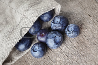ripe blueberries falls of sack bag