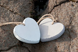 wooden love hearts on the sand bank