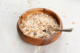 Muesli with raisin and fruits in wooden bowl