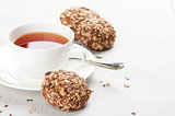 Cup of tea and healthy oat cookies