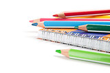 pencils and notebook on white background