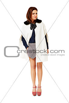Attractive woman in a white poncho