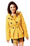 Attractive smiling woman in yellow coat