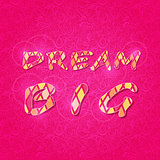 Shiny Dream Big Phrase on Pink Backdrop