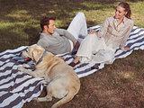 couple having rest with dog