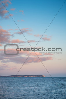 Beautiful sunset cloud formation over calm sea landscape