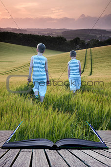 Book concept Concept landscape young boys walking through field