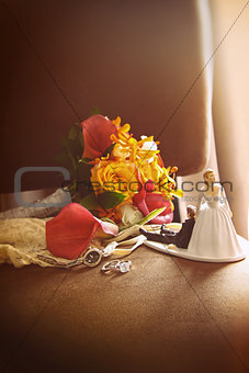 Cake figurines with bouquet on chair