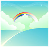 mountain slope and rainbow in sky