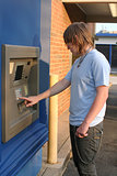 Teen Boy Using ATM