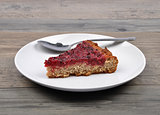 Red currant cake on wood