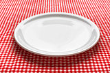 Empty plate on kitchen table