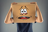 Man with cardboard box on his head and terrified look skethed