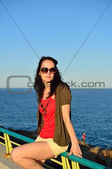 Young woman walking on the beach promenade