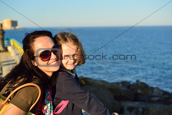 Young woman enjoying a summer evening on the beach with her girl